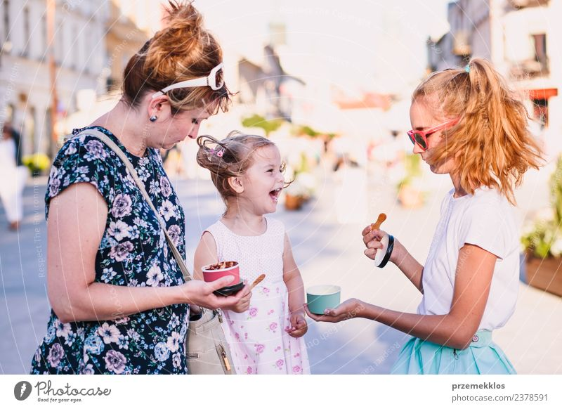 Family spending time together in the city centre Woman Child Human being Vacation & Travel Youth (Young adults) Young woman Summer Town Beautiful Joy Girl