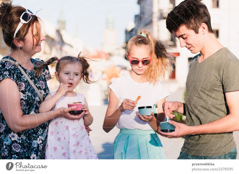 Family spending time together in the city centre Woman Child Human being Vacation & Travel Man Summer Town Beautiful Sun Joy Girl Adults Eating Lifestyle