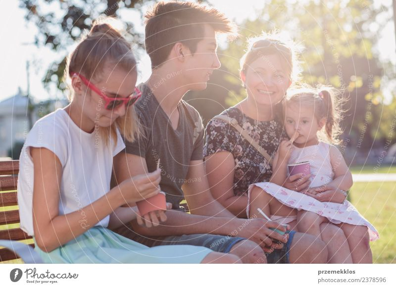 Family spending time together in the city centre Woman Child Human being Vacation & Travel Man Summer Town Beautiful Sun Joy Adults Eating Lifestyle
