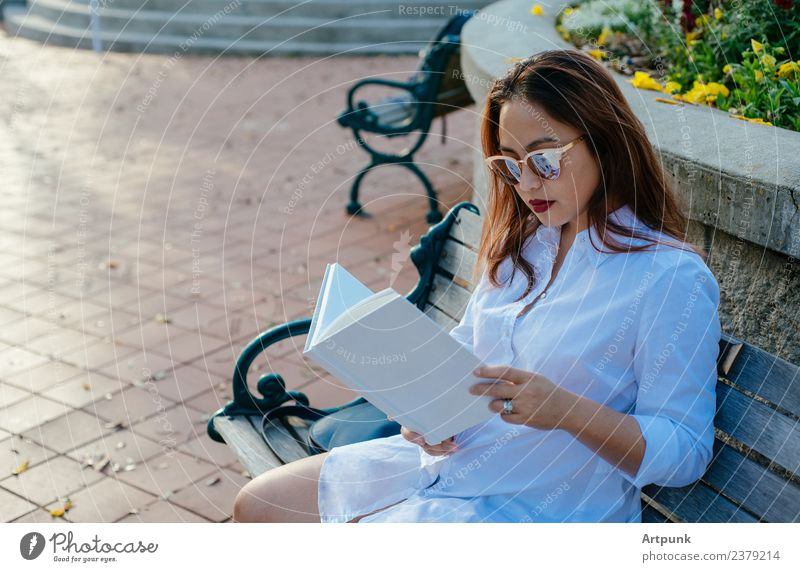 Young Asian woman reading a book Book bibliophile Reading White Shirt Bench Park Education School Literature Sit Sunglasses Word Binding Relaxation