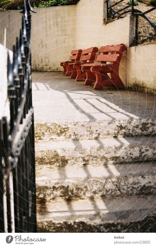 Have a seat! Wood Shadow Red Beige Calm Europe Bench Stairs Gate mediaterran Wait Relaxation