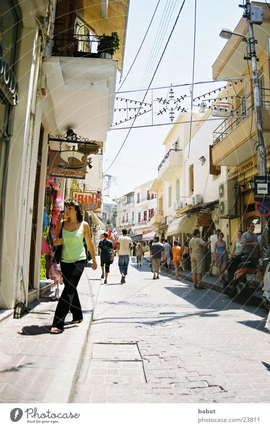 Human being Sun Vacation & Travel Street Warmth Shopping Europe Physics Hot Greece Pedestrian Alley Old town Greek