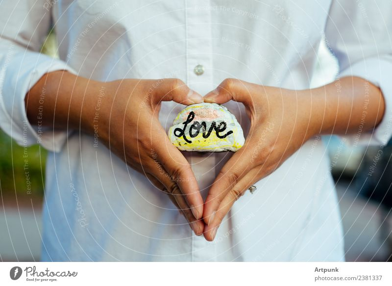 A rock with the word love written on it. Love Pregnant Rock Painting and drawing (object) Paints and varnish Art Heart-shaped Shirt White Fingers Hand Arm