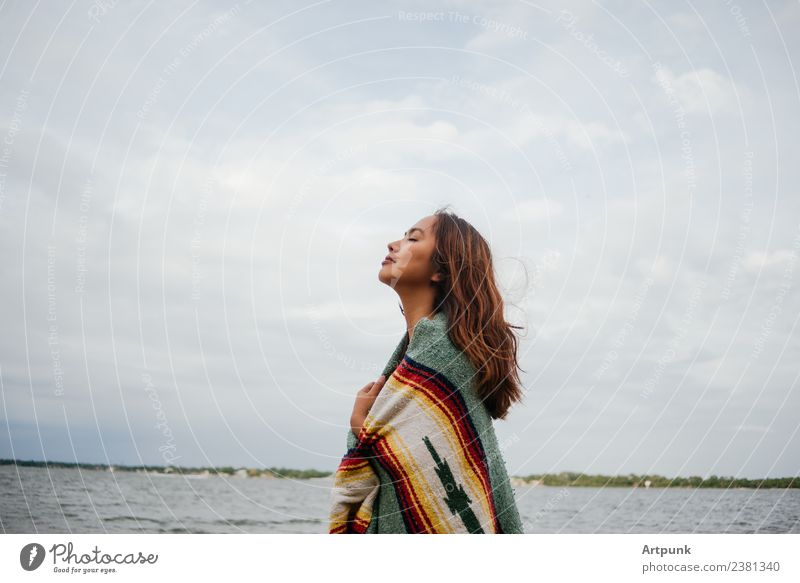 A young woman wrapped in a blanket (horizontal) Horizontal Sky Clouds Cold Blanket Nature Camping Hiking Vacation & Travel Woman 18 - 30 years Young woman Long