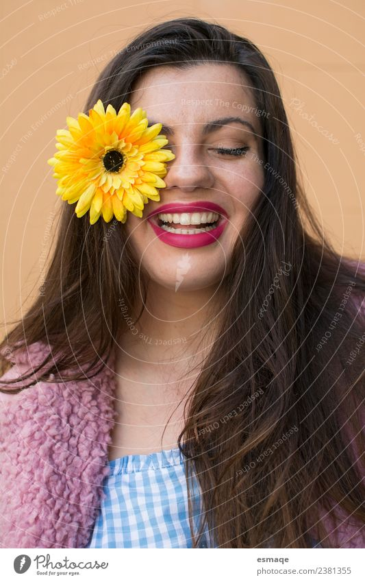 Portrait of Young woman smiling with a flower in her eye Lifestyle Joy Beautiful Face Healthy Wellness Feminine Youth (Young adults) Flower Fashion Smiling