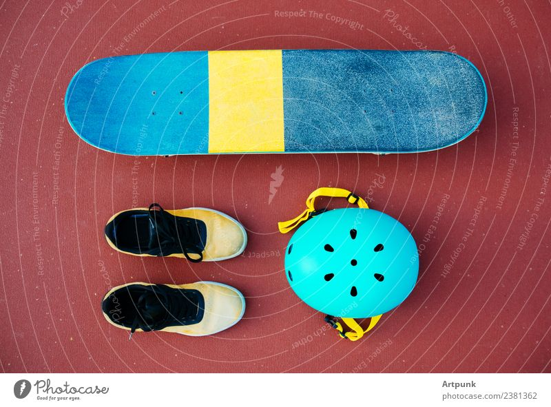 A skateboard, a pair of shoes, and a helmet Skateboard Footwear Helmet Skateboarding Ice-skating Extreme Sports Exterior shot Safety Colour Multicoloured