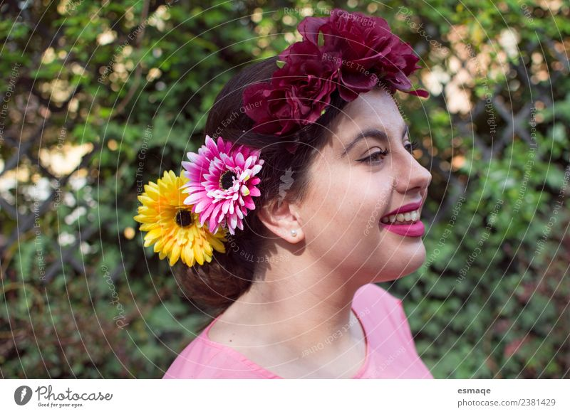 Portrait of Young woman with flower in her hair Human being Youth (Young adults) Beautiful Flower Joy Lifestyle Natural Emotions Feminine Laughter Happy Fashion