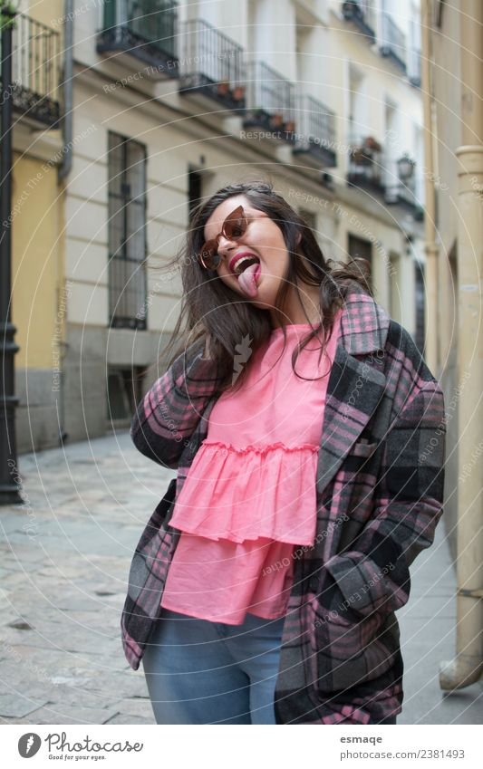 funny woman in street Lifestyle Style Joy Beautiful Healthy Wellness Contentment Young woman Youth (Young adults) Woman Adults Village Small Town Wall (barrier)
