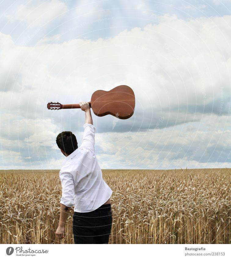 Human being Sky Joy Music Success Shirt Guitar Fame Musical instrument Enthusiasm Image (representation) Musician Emotions Singer Clouds in the sky Wheatfield