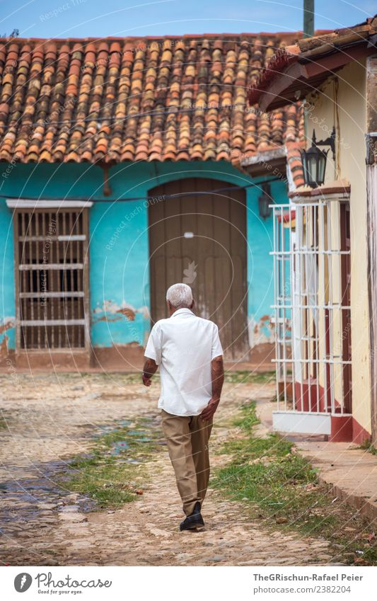 walking down the street Town Old town Blue Brown Gray Green Turquoise White Cuba Cuban Walking Trinidade Grating Human being Man Gray-haired Door Brick