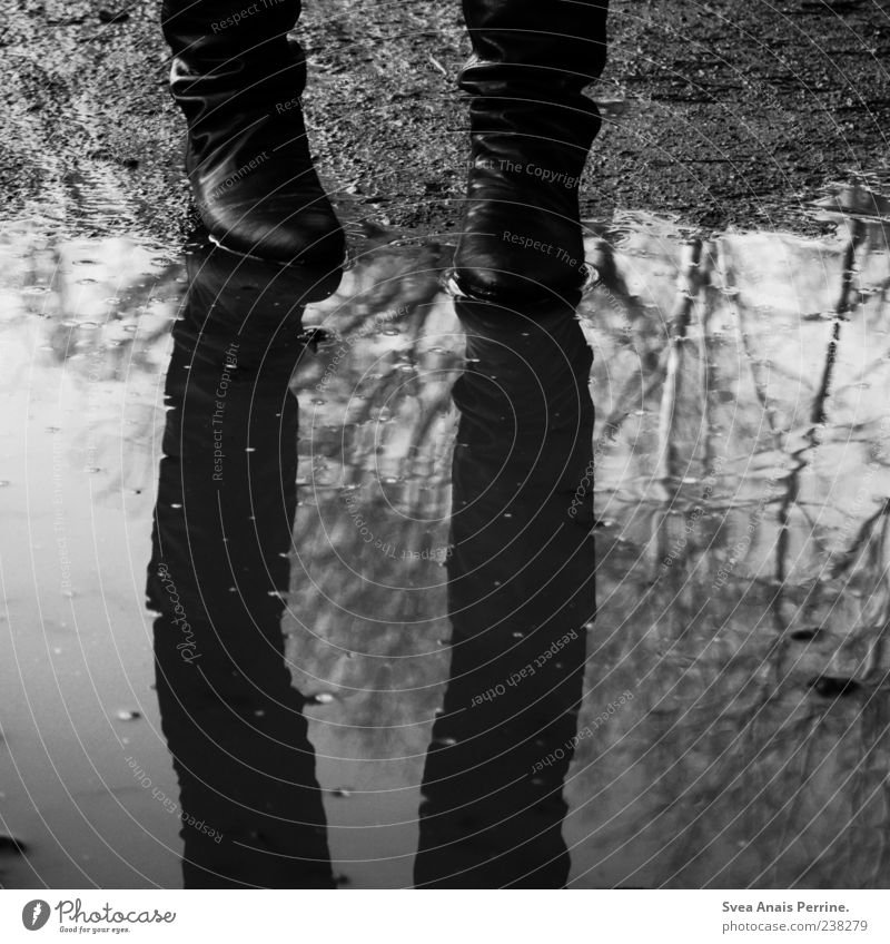 Human being Youth (Young adults) Water Sadness Footwear Dirty Young woman Stand Gloomy Grief Boots Concern Puddle Bad weather Mirror image Reflection