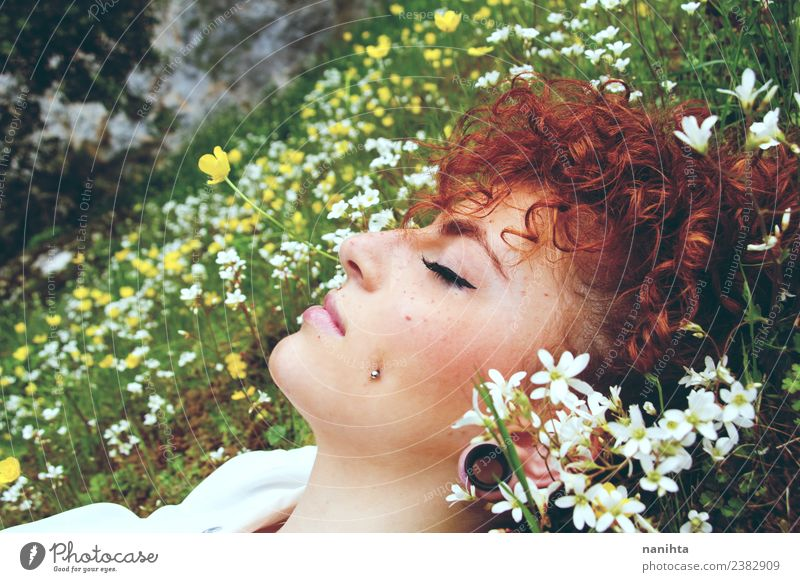 Young woman sleeping in a field of flowers Lifestyle Style Beautiful Hair and hairstyles Skin Face Healthy Senses Relaxation Calm Meditation Fragrance