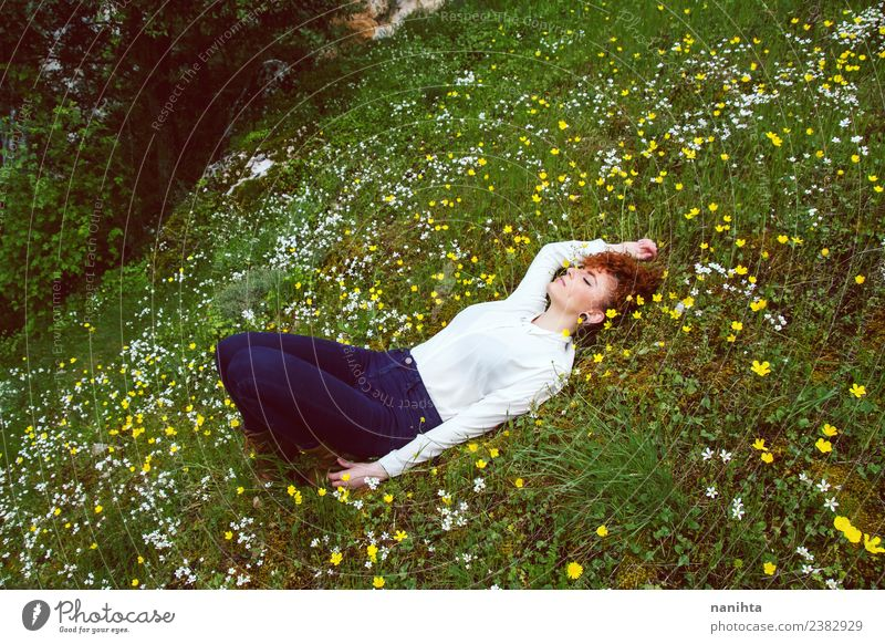Young woman resting in a field of flowers Woman Human being Nature Vacation & Travel Youth (Young adults) Beautiful Green Landscape Flower Relaxation Calm Joy