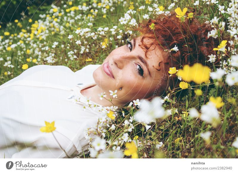 Young woman resting in a field of flowers Woman Human being Nature Youth (Young adults) Summer Beautiful Green Flower Relaxation Joy 18 - 30 years Lifestyle