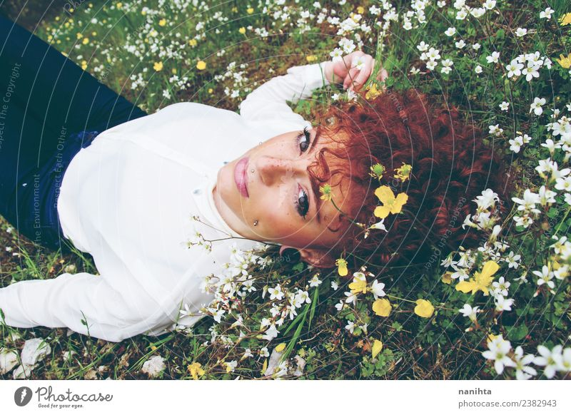 Young woman resting in a field of flowers Lifestyle Elegant Style Hair and hairstyles Skin Face Healthy Wellness Relaxation Calm Fragrance Vacation & Travel
