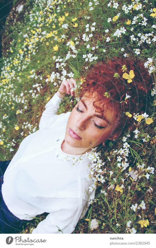Young redhead woman sleeping in a field of flowers Lifestyle Elegant Beautiful Hair and hairstyles Skin Face Healthy Wellness Harmonious Well-being Senses