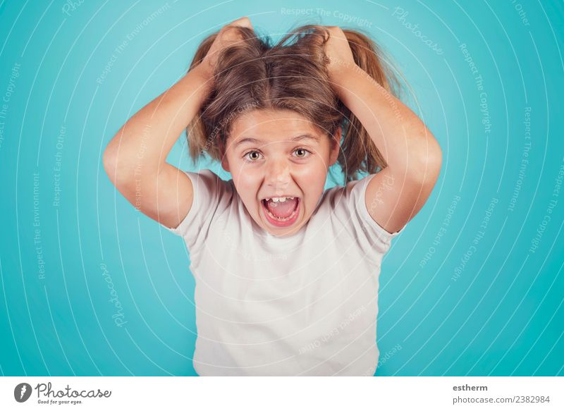 portrait of angry girl on blue background Lifestyle Human being Feminine Child Girl Infancy 1 8 - 13 years To talk To hold on Fitness Scream Aggression Creepy