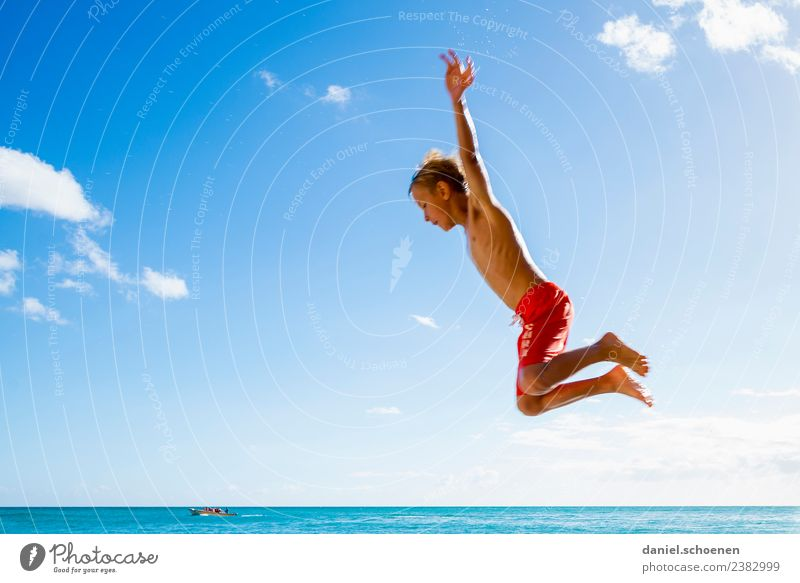 Child Human being Sky Vacation & Travel Summer Blue Sun Ocean Joy Beach Emotions Movement Boy (child) Happy Tourism Bright