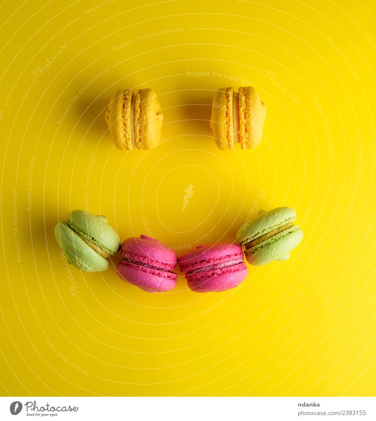 multicolored baked pastry with almond flour Dessert Candy Smiling Bright Yellow Green Pink Colour Tradition Macaron Baked goods Almond assortment background