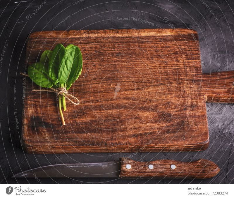 cutting board and bunch with green sorrel Herbs and spices Table Kitchen Nature Plant Leaf Wood Old Fresh Natural Above Brown Green Black background empty food