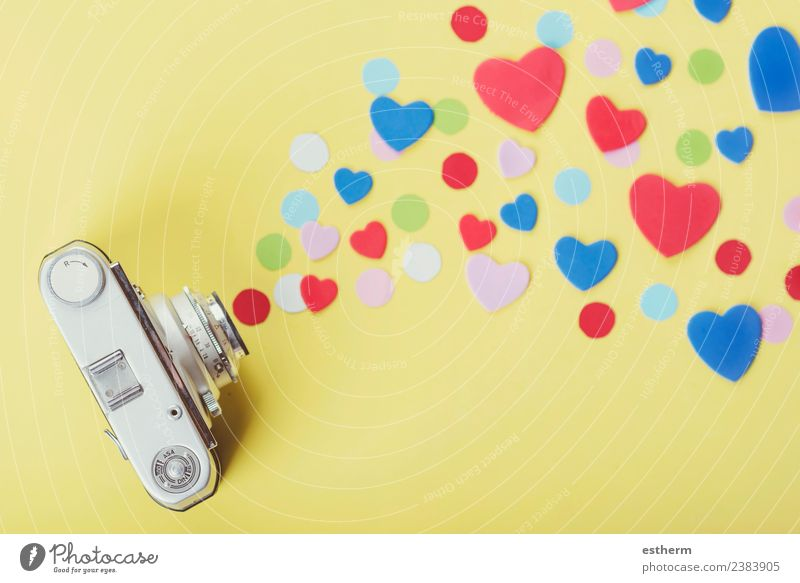 photo camera with hearts on yellow background Lifestyle Joy Vacation & Travel Party Event Feasts & Celebrations Valentine's Day Mother's Day Camera Heart Dream