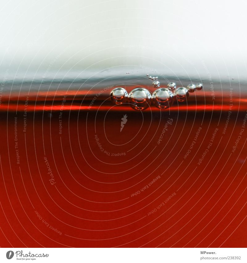 Bubbles V Water Exceptional Wet Round Brown Fluid Surface tension Many Small Beverage Glass Red Colour photo Interior shot Detail Deserted Copy Space top