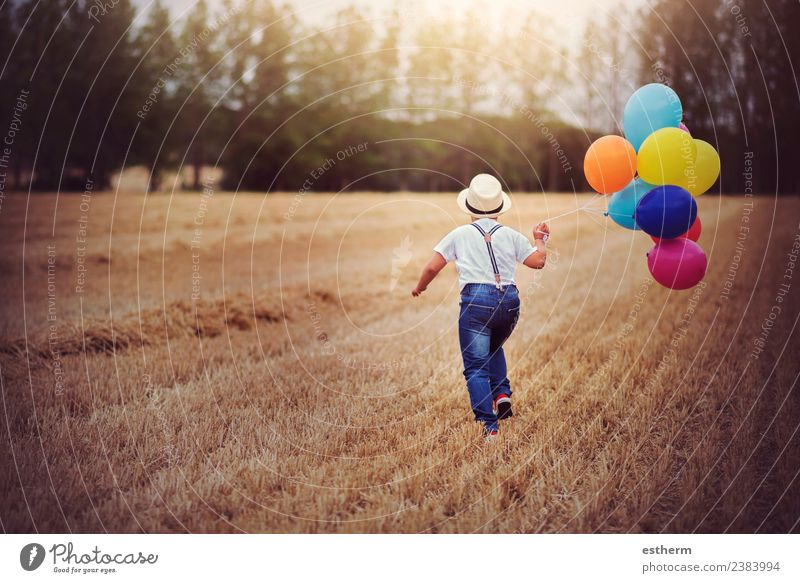 boy running through the field with balloons Lifestyle Joy Vacation & Travel Trip Adventure Freedom Entertainment Party Feasts & Celebrations Birthday Masculine