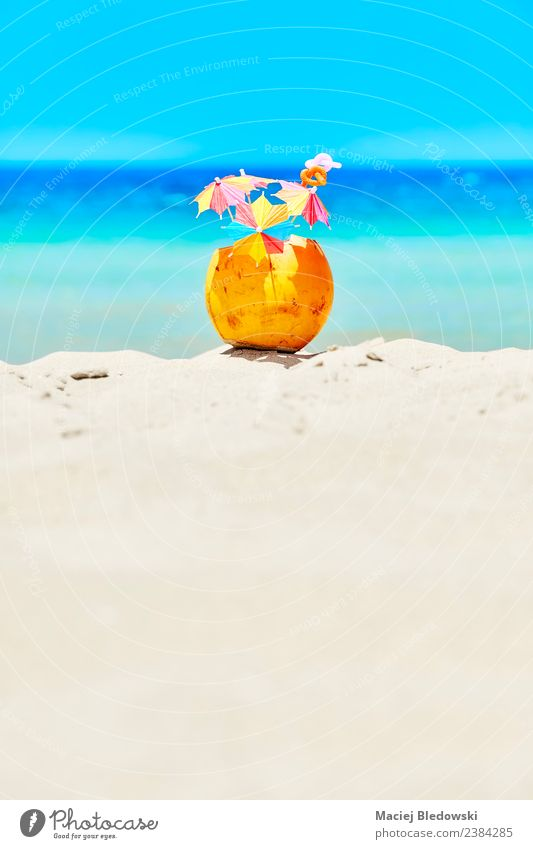 Coconut with colorful umbrellas and straws on a beach. Fruit Beverage Cold drink Lifestyle Luxury Joy Relaxation Vacation & Travel Tourism Summer