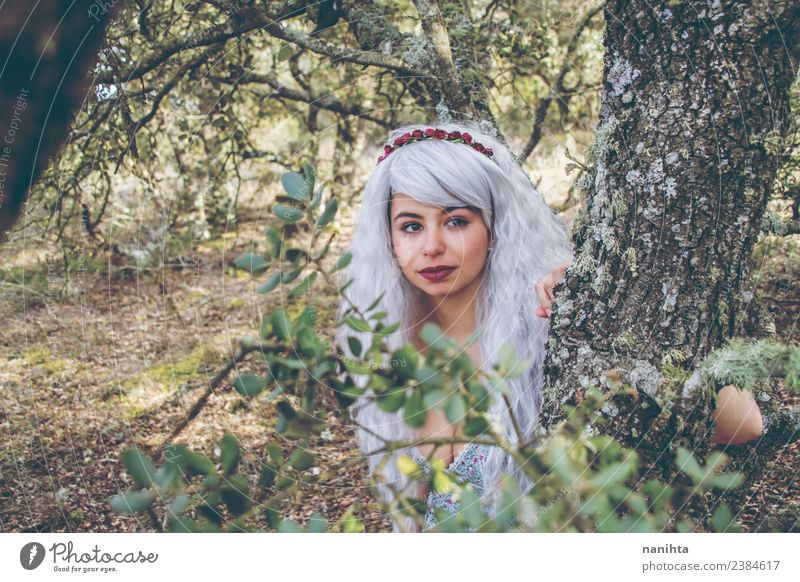 Beautiful young woman in a forest Lifestyle Style Design Exotic Hair and hairstyles Wellness Senses Calm Human being Feminine Young woman Youth (Young adults)