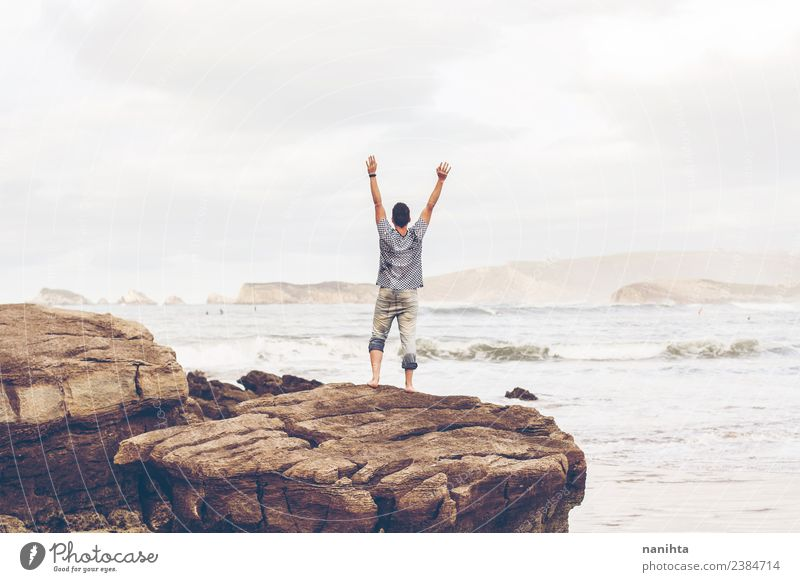 Young man alone in front of the sea Human being Nature Vacation & Travel Youth (Young adults) Man Young woman Summer Landscape Ocean Clouds Beach Far-off places
