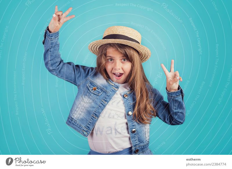 portrait of happy girl with hat on blue background Child Human being Vacation & Travel Joy Girl Lifestyle Funny Emotions Feminine Style Happy Tourism Freedom