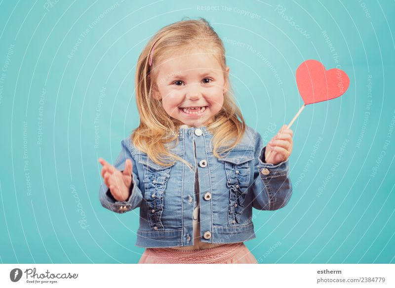 smiling baby with a heart on blue background Lifestyle Joy Feasts & Celebrations Valentine's Day Mother's Day Human being Feminine Baby Girl Infancy 1