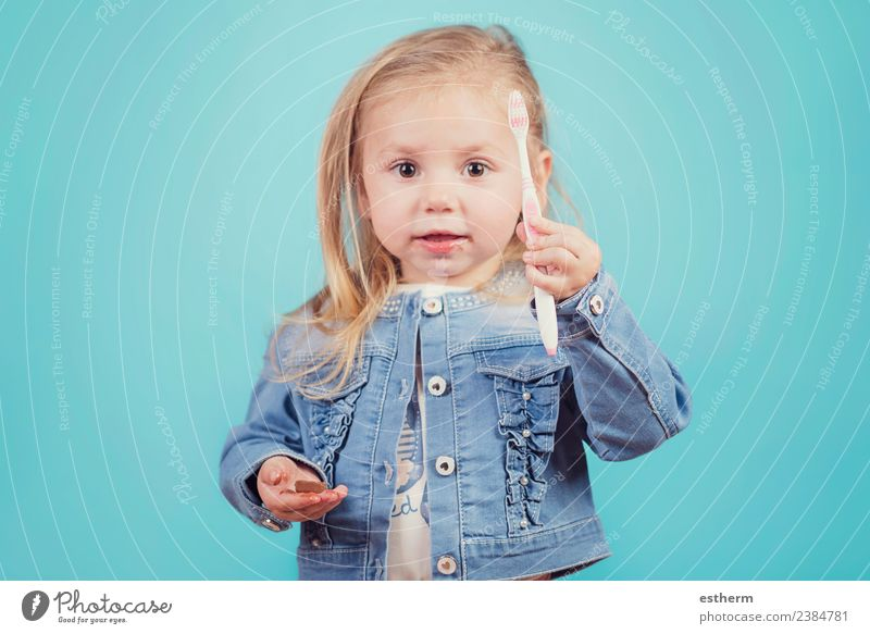 little girl with toothbrush on blue background Joy Personal hygiene Human being Feminine Baby Girl Infancy 1 3 - 8 years Child Toothbrush To hold on Fitness