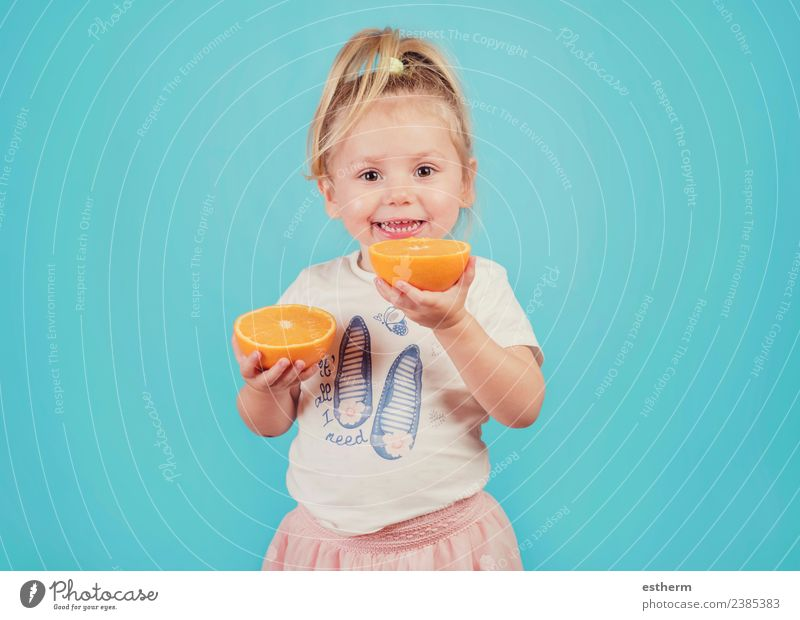 smiling baby with an orange on blue background Food Fruit Orange Nutrition Eating Lunch Joy Healthy Eating Human being Feminine Baby Girl Infancy 1 3 - 8 years