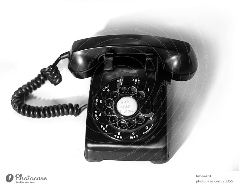 Phone Telephone Rotary dial Sixties Telecommunications Audience Cable Black & white photo sixtees bakelite
