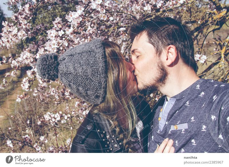 Young couple kissing in a sunny spring day Lifestyle Style Joy Wellness Harmonious Senses Human being Masculine Feminine Young woman Youth (Young adults)