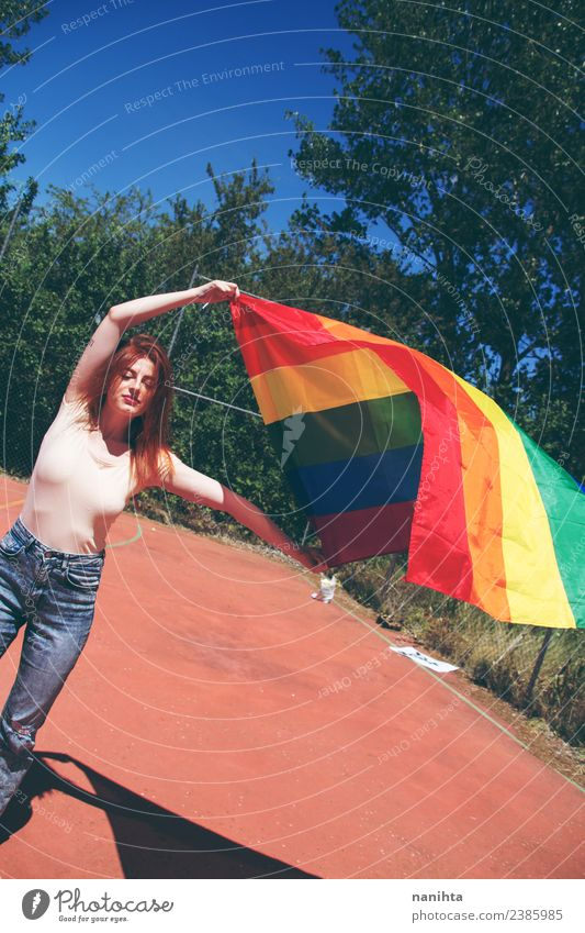 Young woman holding a rainbow flag Lifestyle Style Design Human being Feminine Homosexual Youth (Young adults) 1 18 - 30 years Adults Culture Youth culture