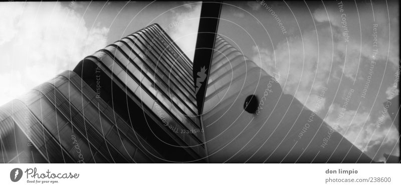 astra tower Clouds High-rise Building Facade Sharp-edged Gigantic Large Tall Modern Black White Perspective Analog Black & white photo Exterior shot Lomography