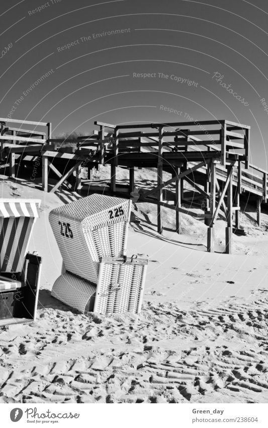 Vacation & Travel Beach Sand Digits and numbers Beautiful weather Tracks Footbridge Beach chair Cloudless sky Sylt Black & white photo