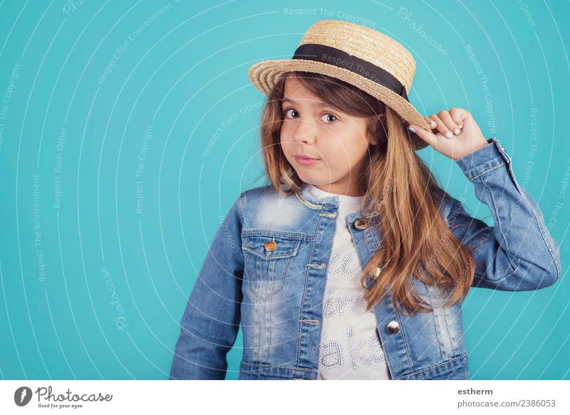 portrait of happy girl with hat on blue background Child Human being Vacation & Travel Joy Girl Lifestyle Funny Emotions Feminine Style Tourism Trip Elegant