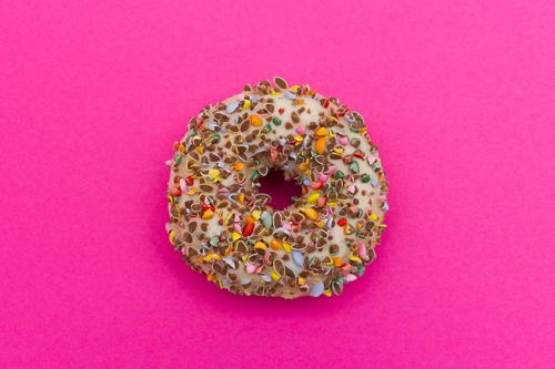 Sugar sweet donut on pink background Food Cake Candy Donut Eating Fragrance Happy Delicious Round Sweet Multicoloured Pink Vice Appetite To enjoy Nutrition