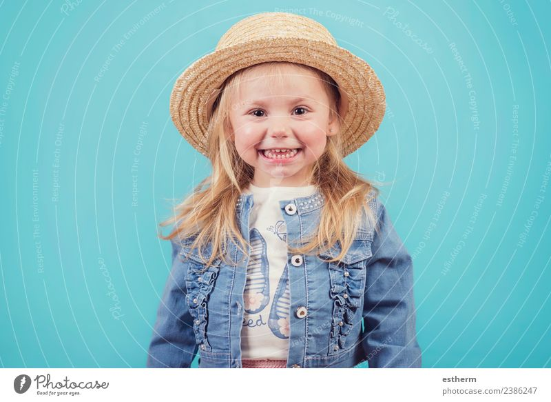 happy and smiling baby with hat on blue background Lifestyle Joy Human being Feminine Baby Girl Infancy 1 3 - 8 years Child Hat Fitness Smiling Laughter