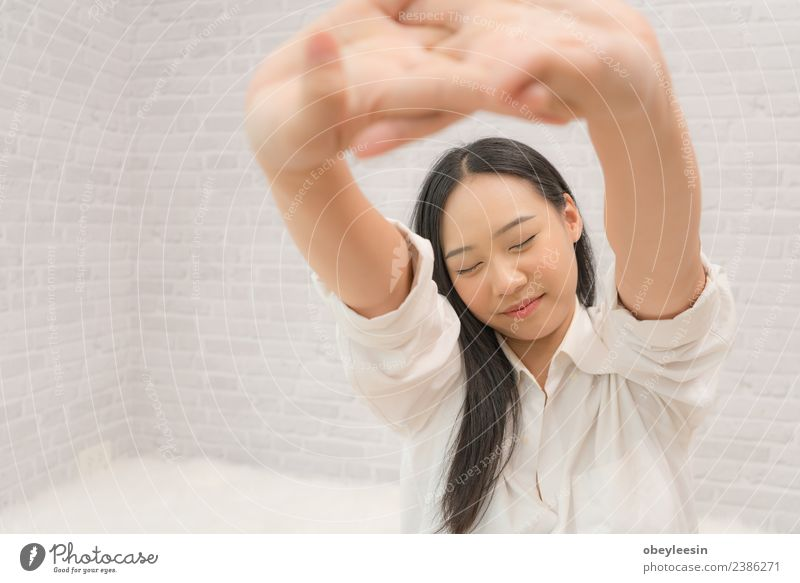 Young beautiful Asian girl waking up after a long sleep Woman Human being Beautiful White Relaxation Joy Adults Lifestyle Happy Copy Space Dream Vantage point