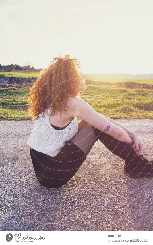 Young redhead woman enjoying the sun at sunset Human being Nature Youth (Young adults) Young woman Beautiful Relaxation Loneliness 18 - 30 years Adults Warmth