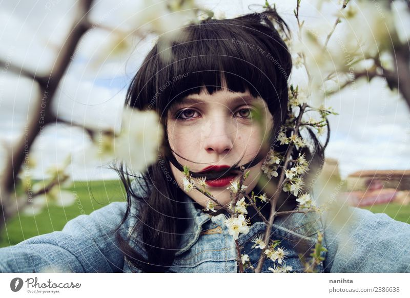 Young brunette woman surrounded by flowers Lifestyle Style Design Beautiful Hair and hairstyles Skin Face Human being Feminine Young woman Youth (Young adults)