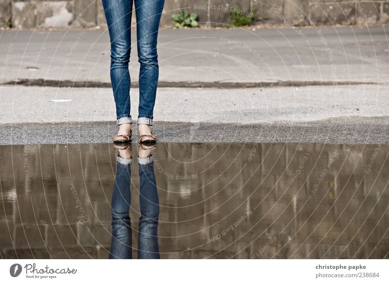 Human being Water Feminine Legs Concrete In pairs Stand Jeans Asphalt Footwear Surface of water Puddle Anonymous Headless Clothing Unidentified
