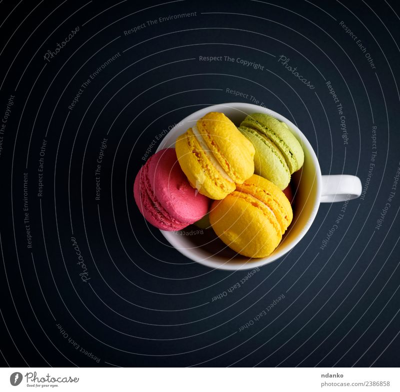 multicolored baked cakes of almond Dessert Candy Bright Blue Yellow Pink Black White Colour Macaron cup mug background food colorful Vanilla french