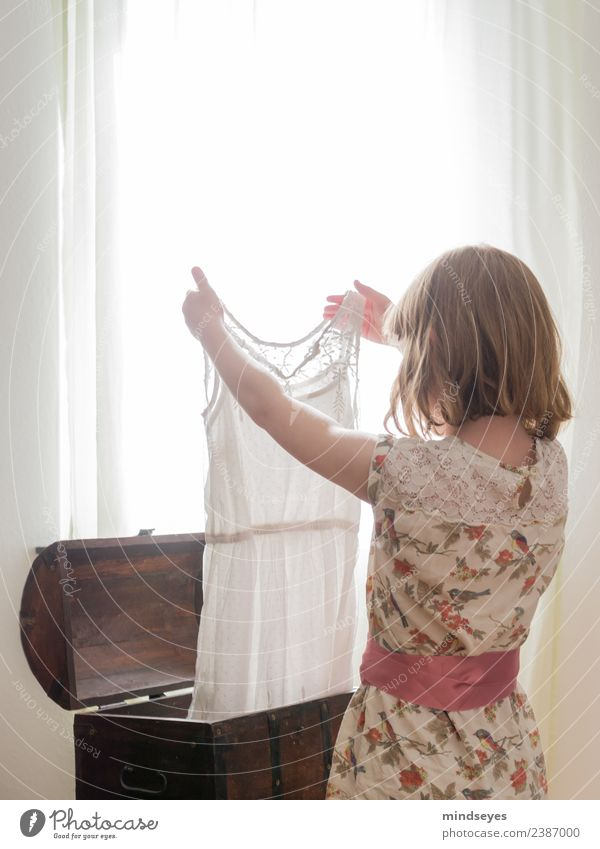 Girl looks at dress against light from window Feminine Infancy 1 Human being 3 - 8 years Child Window Dress Chest Blonde Box Looking Stand Dream Growth Bright
