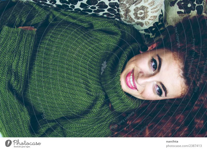 Young woman lying down in a sofa at home Lifestyle Elegant Style Joy Beautiful Hair and hairstyles Skin Face Sofa Human being Feminine Youth (Young adults) 1