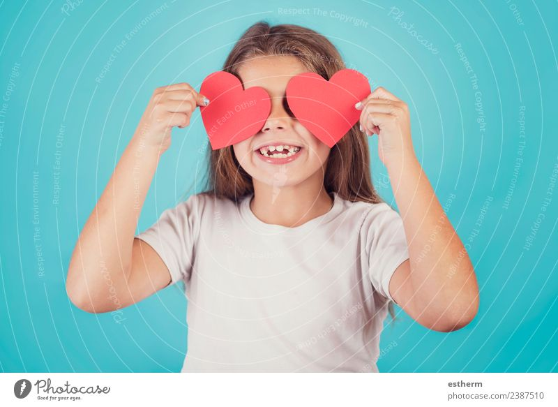 smiling girl with hearts in her eyes on blue background Child Human being Joy Girl Lifestyle Love Funny Emotions Feminine Laughter Party Feasts & Celebrations